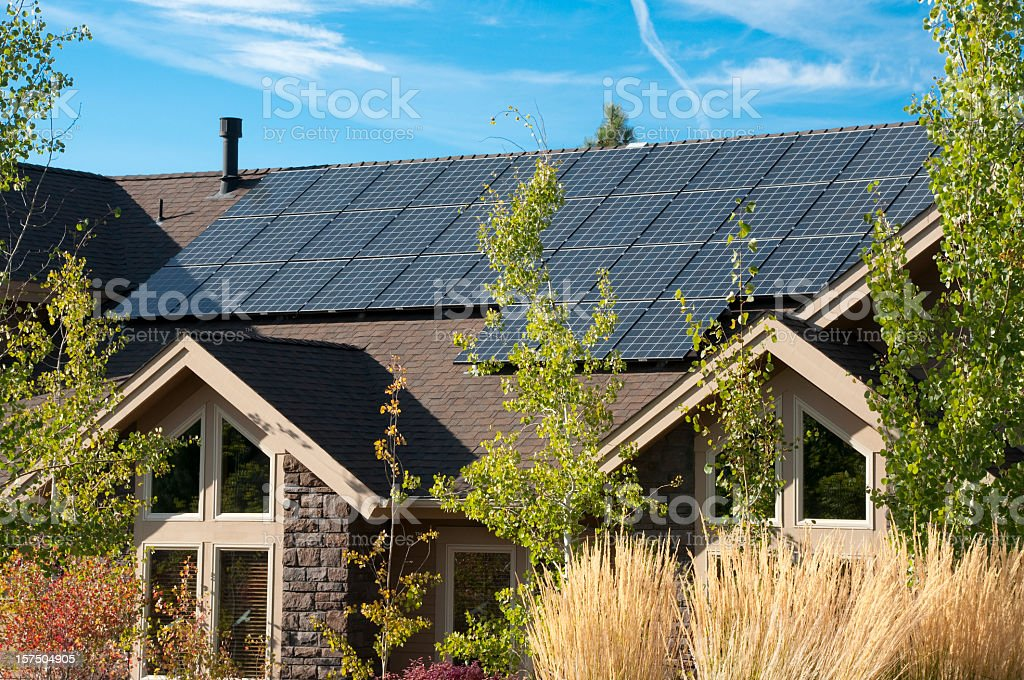 solar panels on the roof of a house stock photo is
