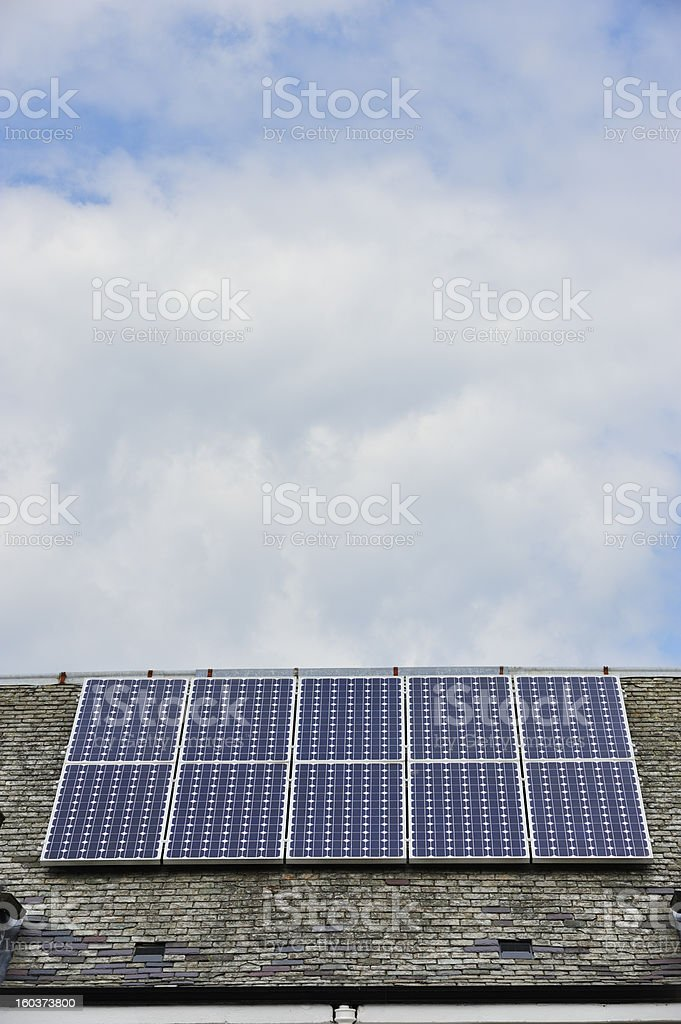 Solar panels on the roof of an old building stock photo
