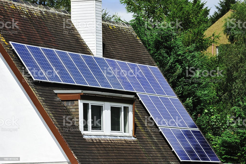 Solar panels on the roof of an old house stock photo
