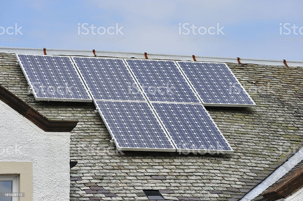 Solar panels on the roof on an old building stock photo