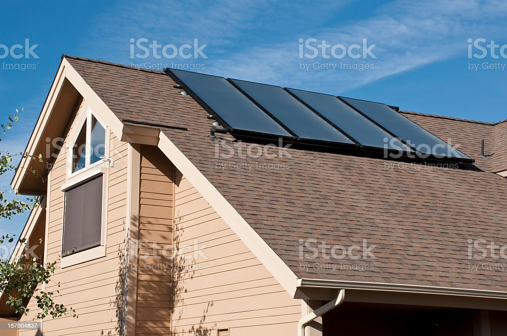 Solar panels on the rooftop of a home royalty-free stock photo