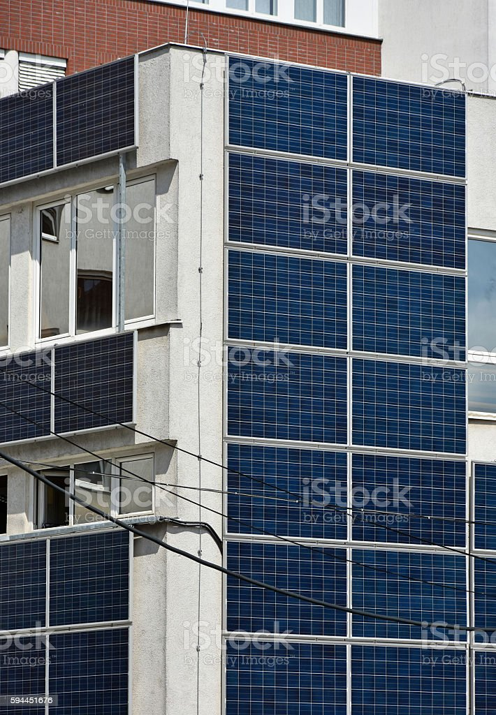 Solar panels on the wall of an office building stock photo