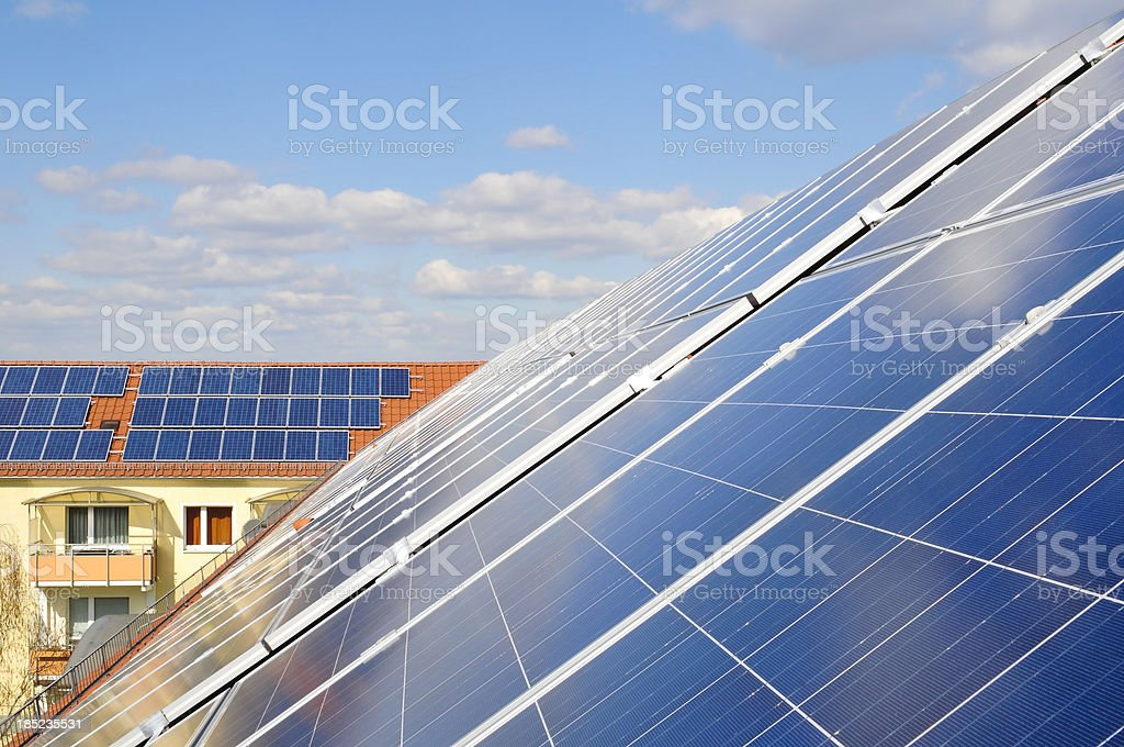 Solar panels on tile roofs stock photo