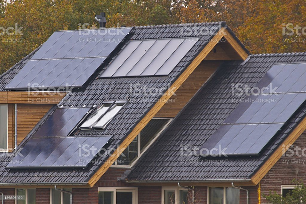 Solar panels on top of the roofs stock photo