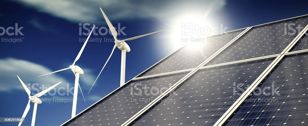 Solar panels or collectors and wind turbines stock photo