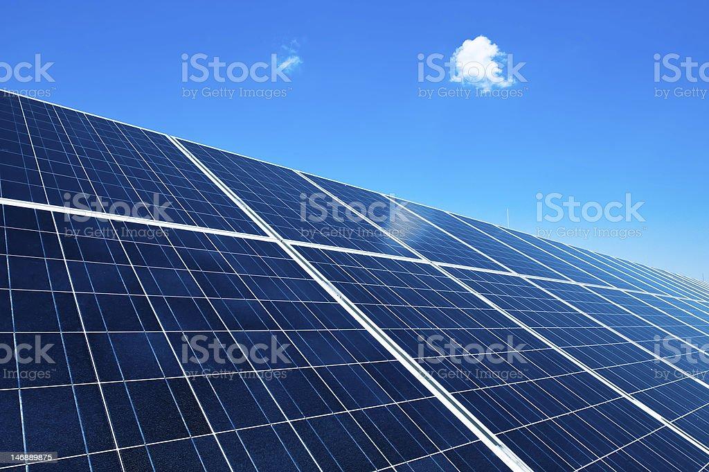 Solar panels under blue sky on a sunny day royalty-free stock photo
