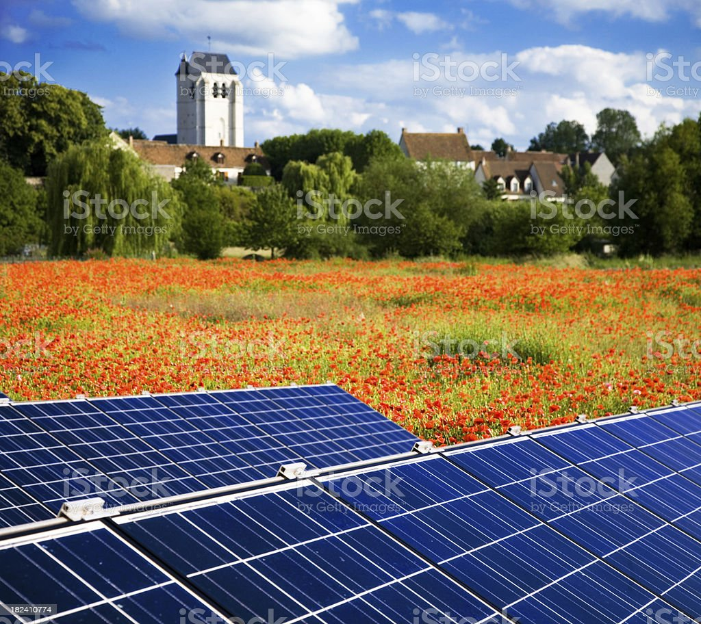 Solar Panels with a Village in the Background royalty-free stock photo
