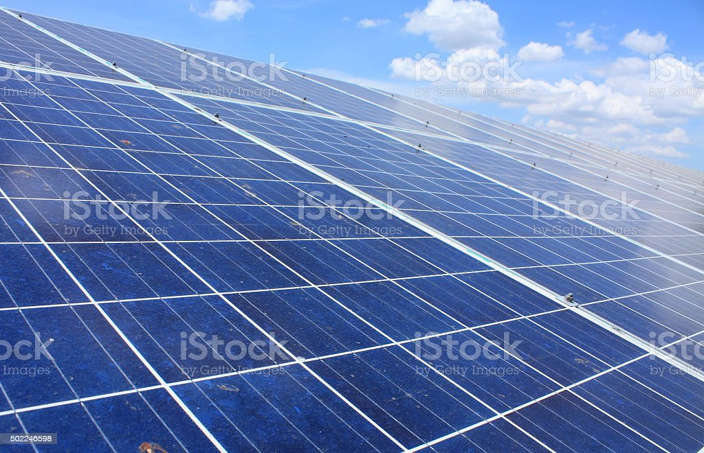 solar panels with blue sky stock photo