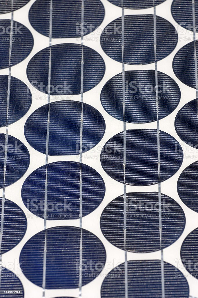 Solar photovoltaic electricity generating panel with circular elements close up royalty-free stock photo