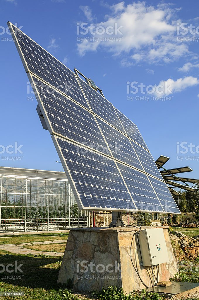 Solar photovoltaic panels and greenhouse royalty-free stock photo