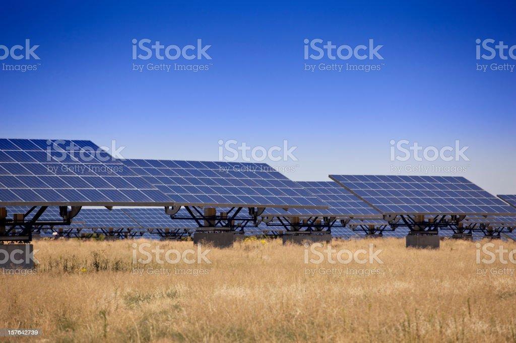 Solar power panels in an empty field stock photo