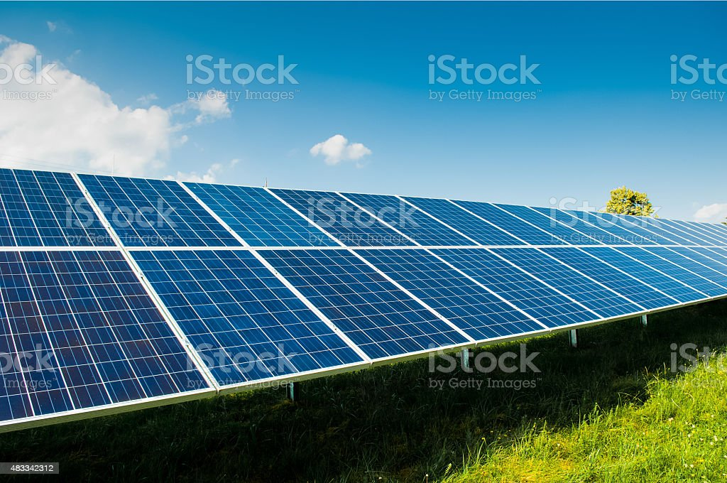 Solar power panels on blue sky and copy space stock photo