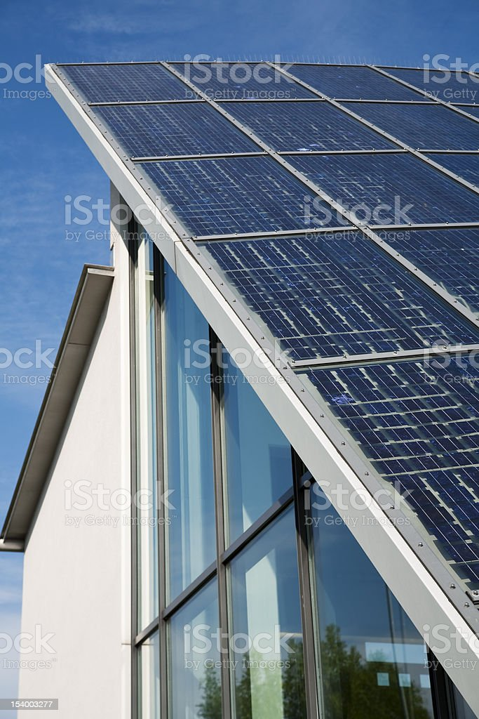 Solar Power Technique on Roof of Modern Office Building royalty-free stock photo