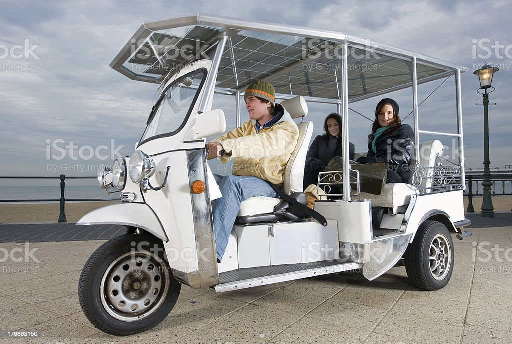 Solar powered tuctuc at the beach royalty-free stock photo