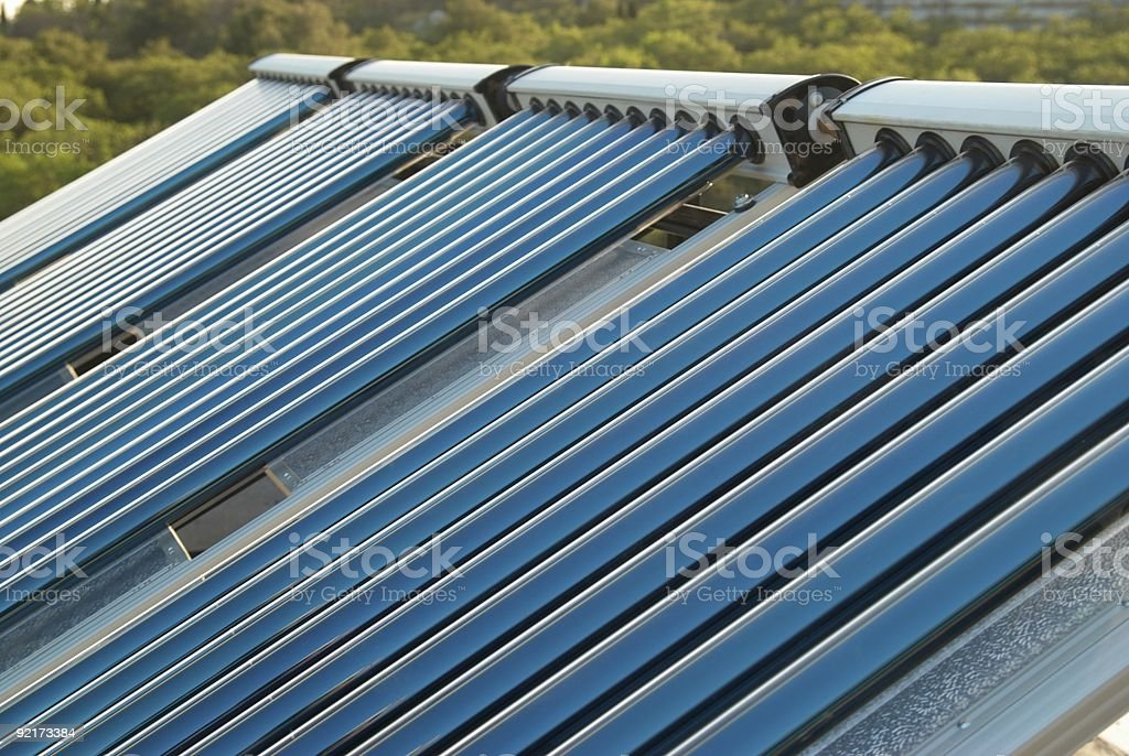 Solar powered water heating system stock photo
