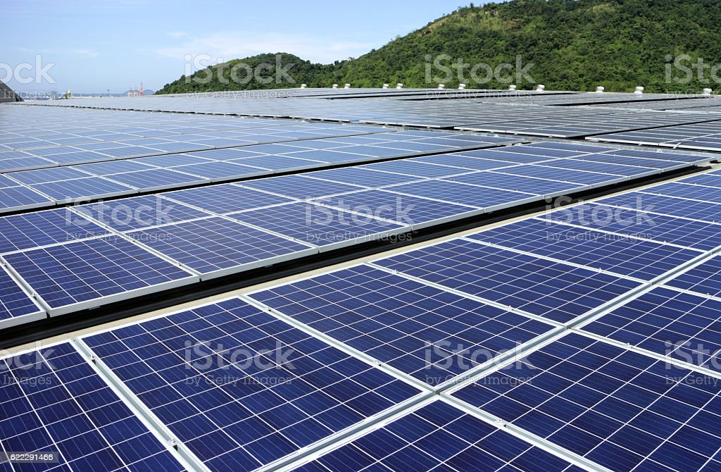 Solar PV Rooftop System Mountain Background stock photo