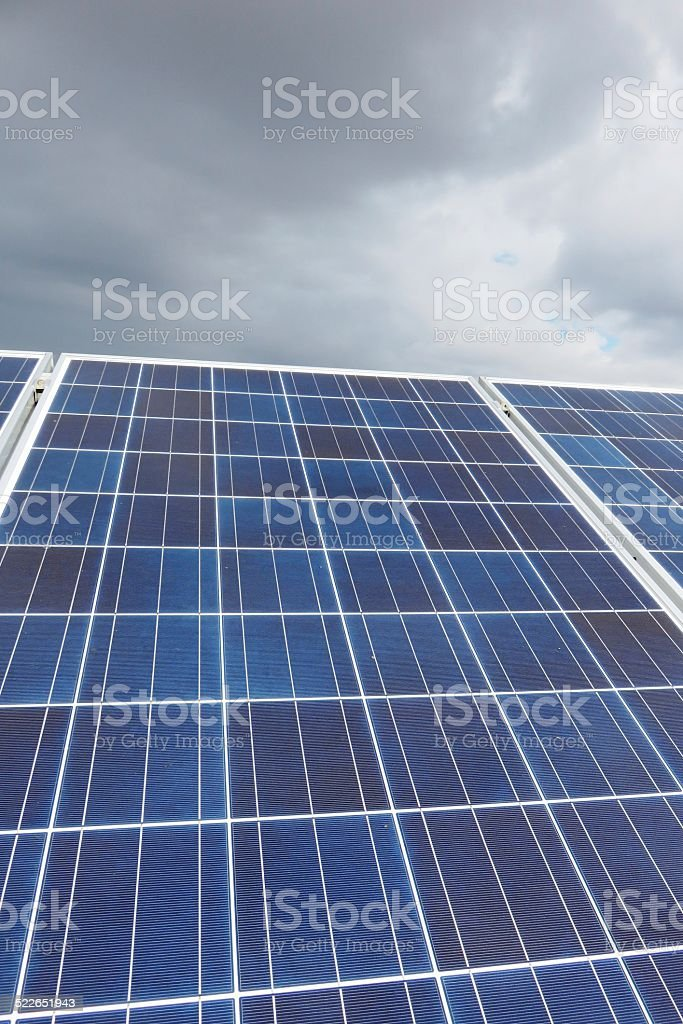 Solar roof, clouds stock photo