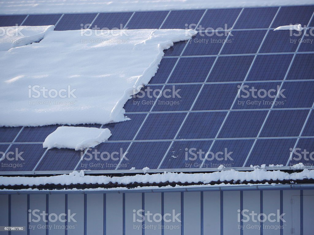 solar roof with snow stock photo