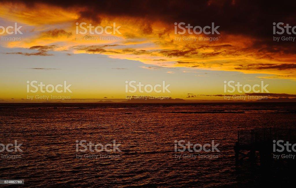 Solar Sunset Behind Cape Point  Across  False Bay. stock photo