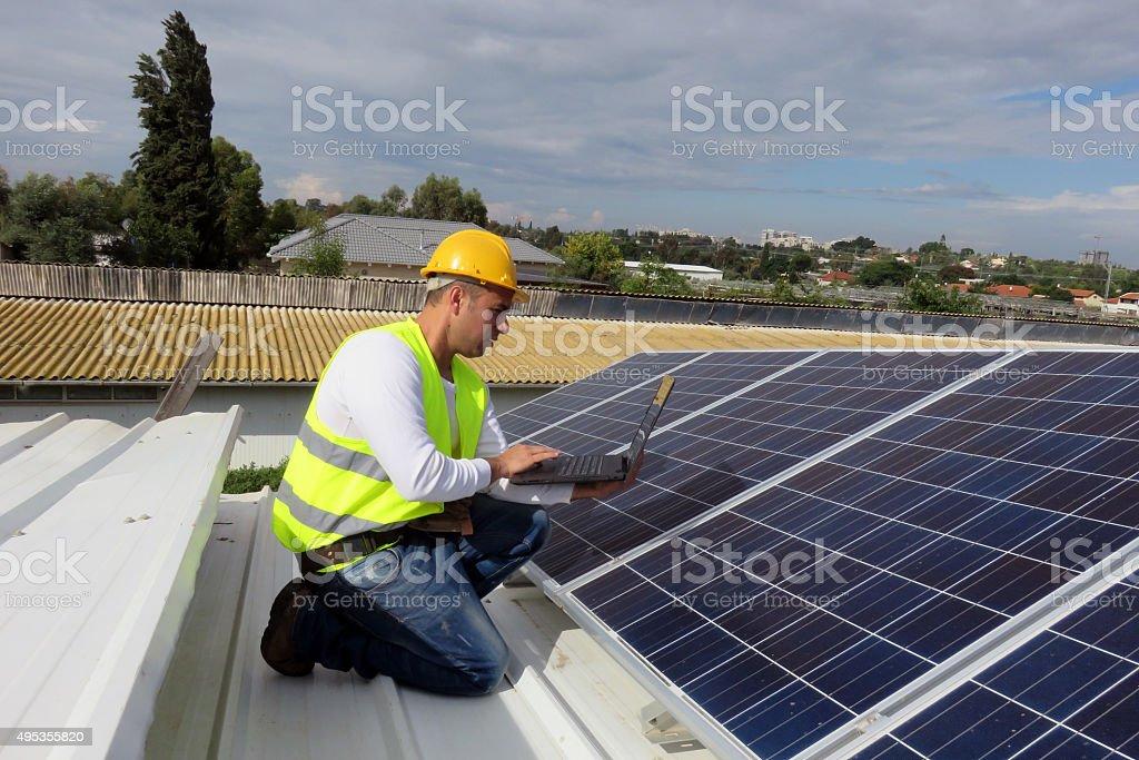Solar technician stock photo