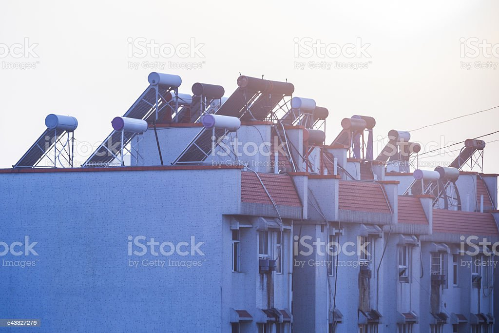 Solar water heaters on top of residential buildings stock photo