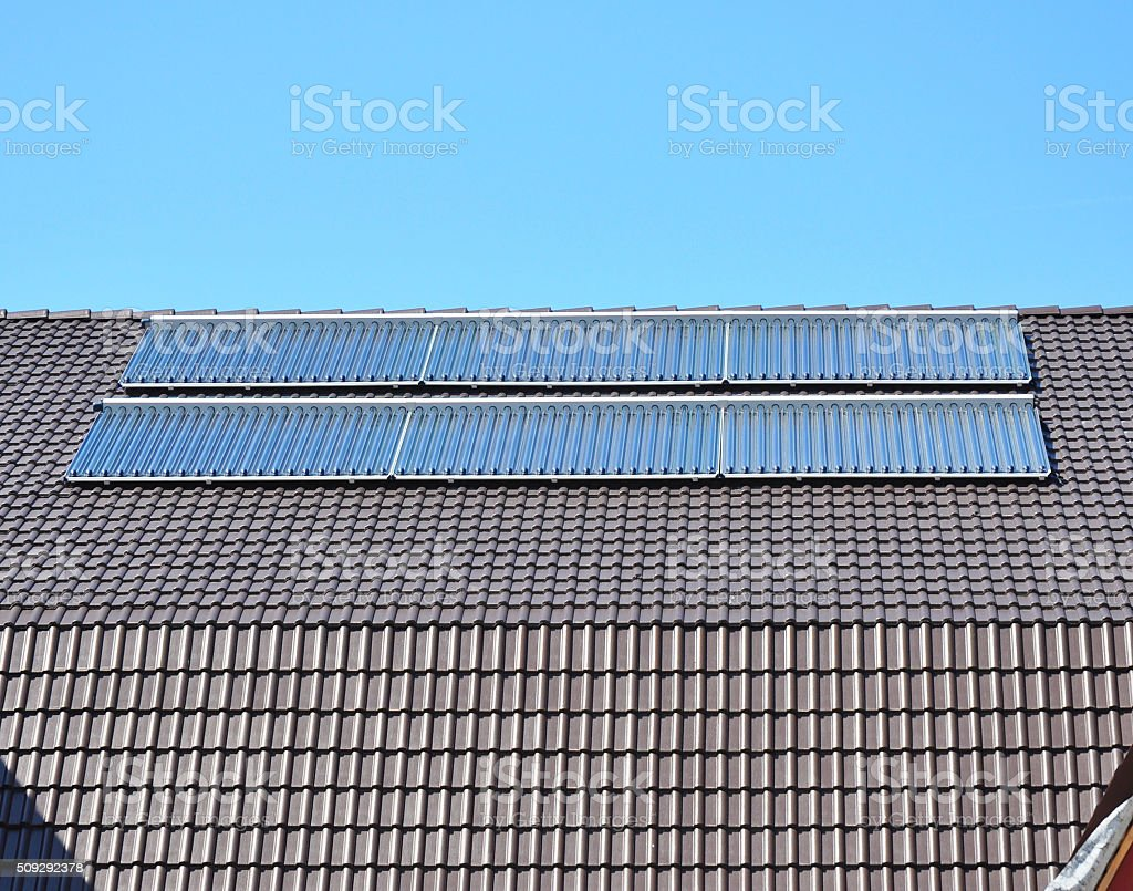 Solar Water Panels Heating on the Roof stock photo