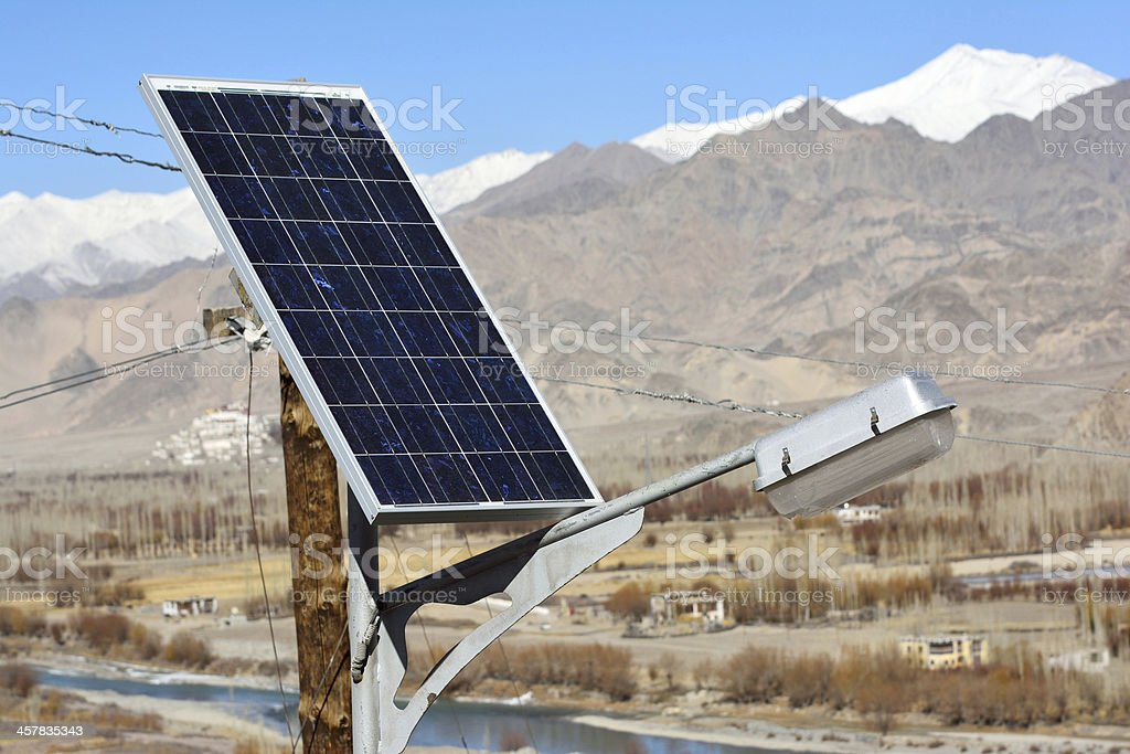 solarcells on a winter roof with snow mountain royalty-free stock photo