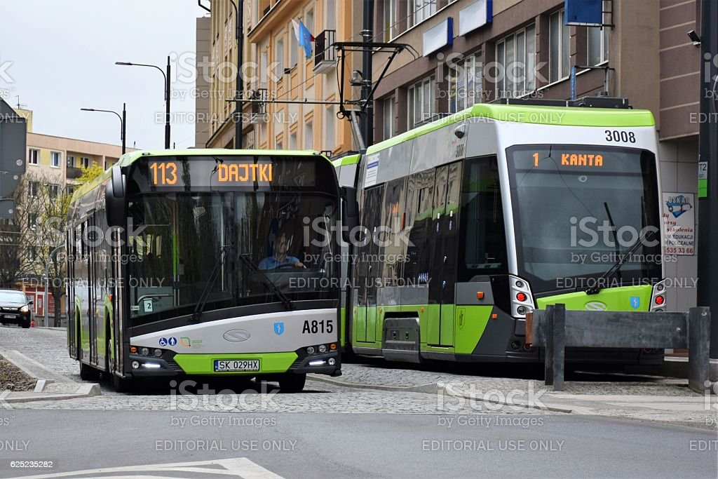 Solaris bus and tram in town stock photo
