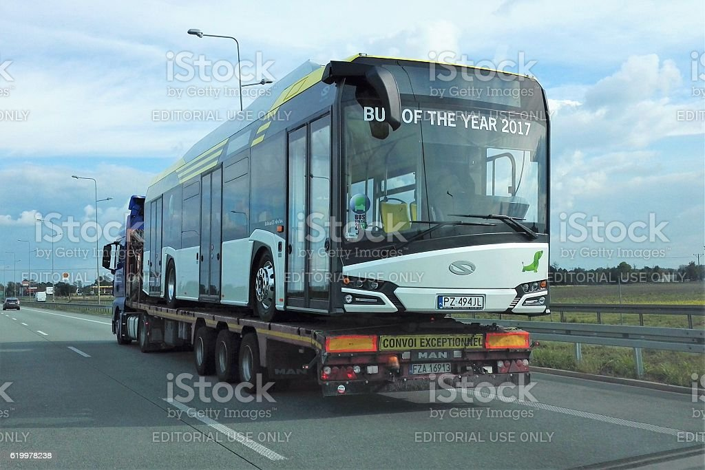 Solaris electric bus on the car transporter stock photo