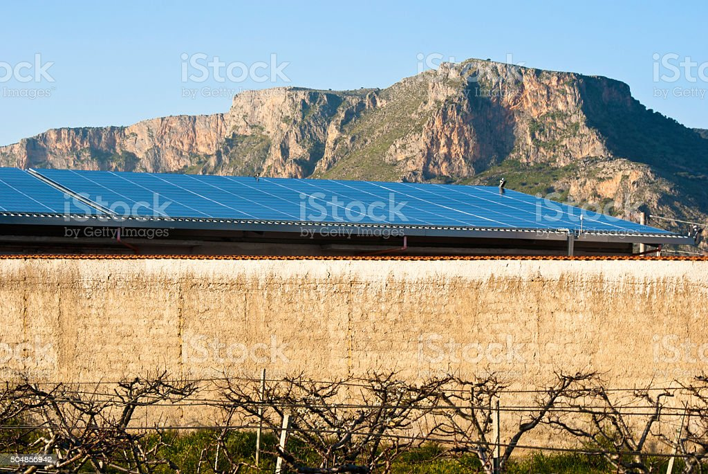 solars panels in the mountain stock photo