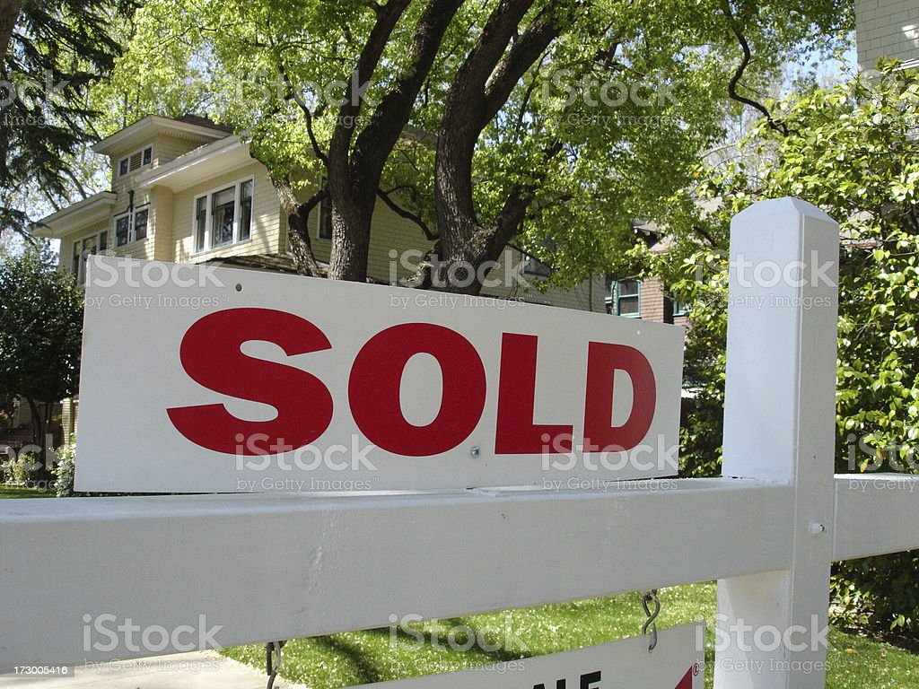 Sold California real estate sign and mansion house home stock photo