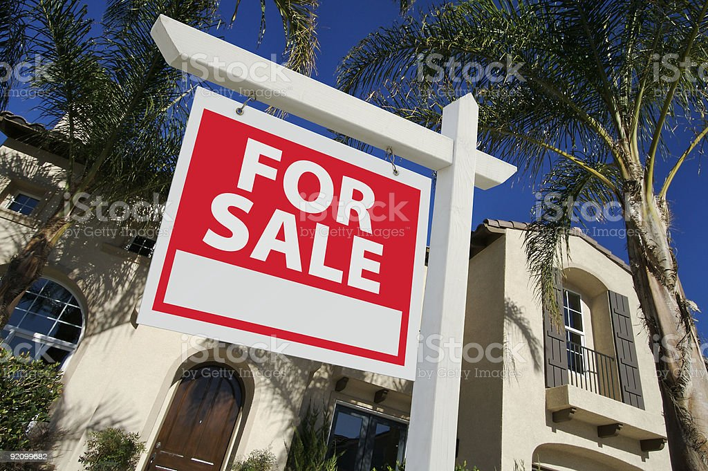Sold Home For Sale Sign and New House stock photo