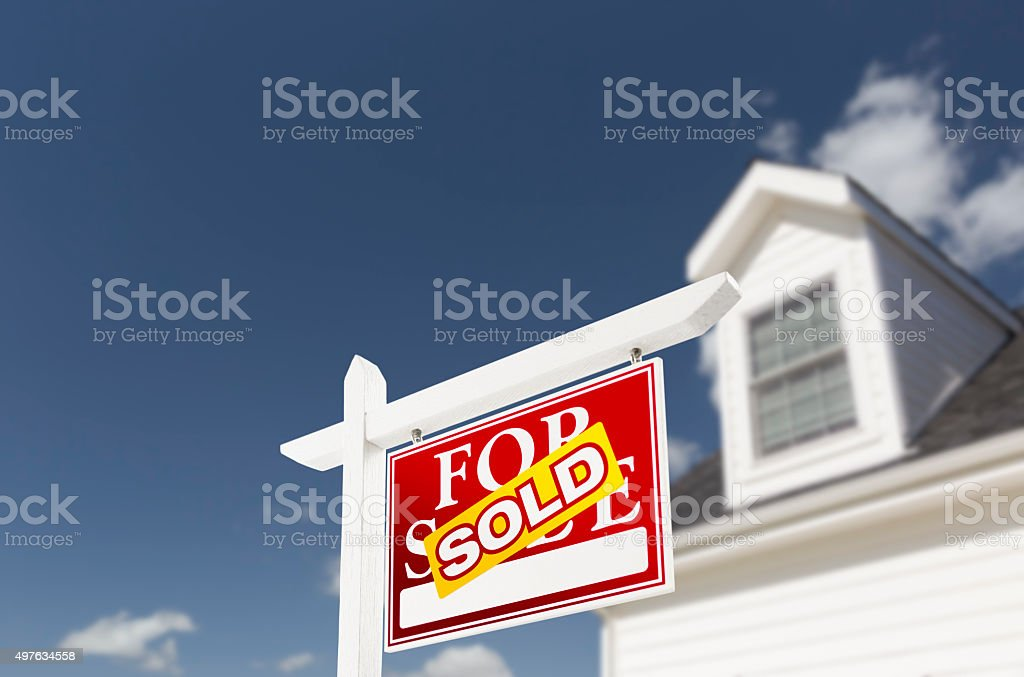 Sold Home For Sale Sign in Front of New House stock photo