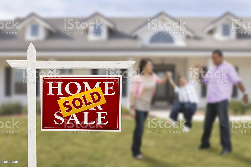 Sold Real Estate Sign and Family in Front of House stock photo