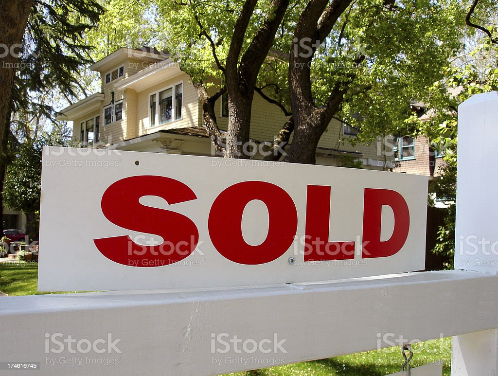 Sold real estate sign stock photo