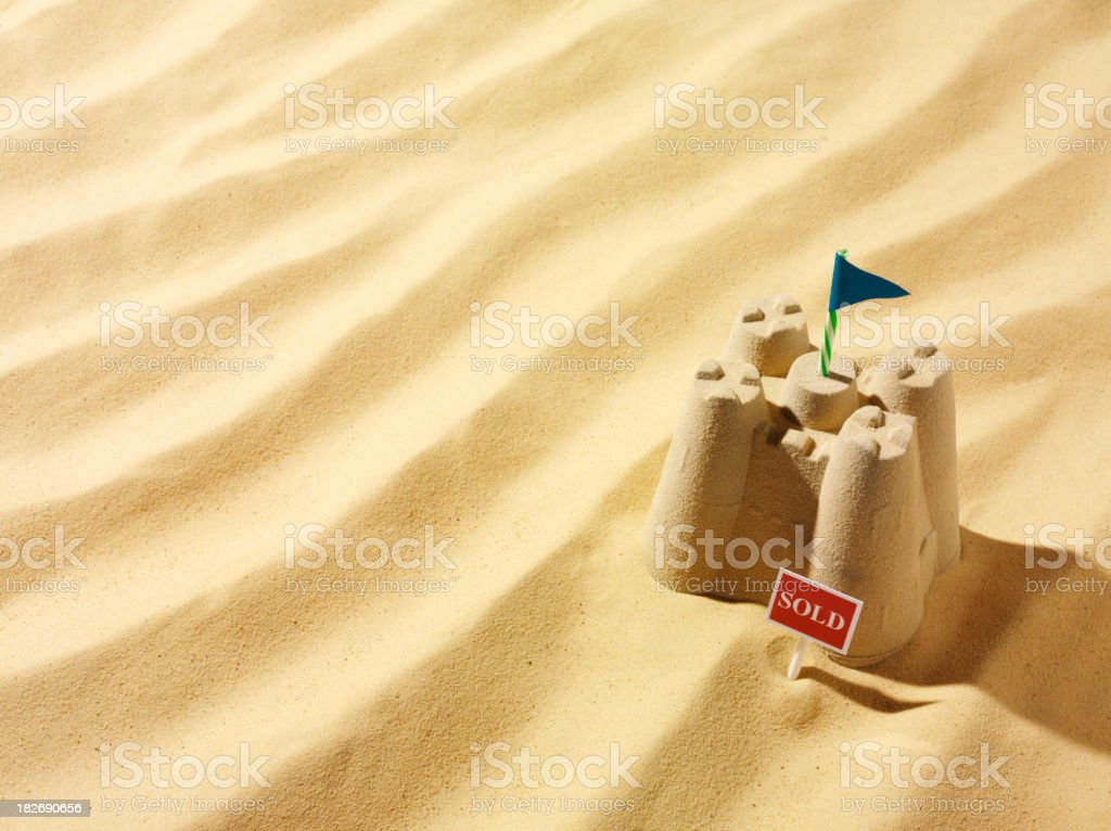 Sold Sign and a Sandcastle royalty-free stock photo