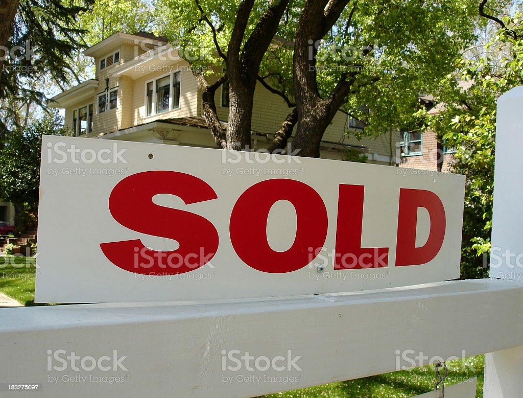Sold sign in front of a large two story California home stock photo