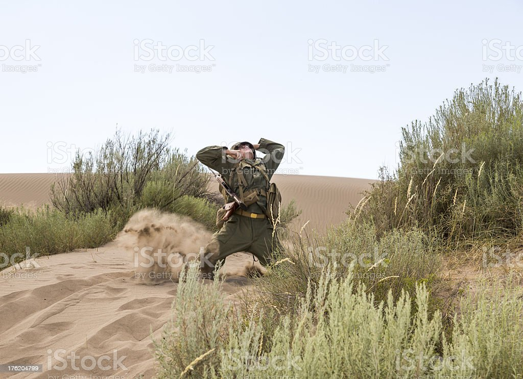 WW2 solder falling to the ground after being shot royalty-free stock photo