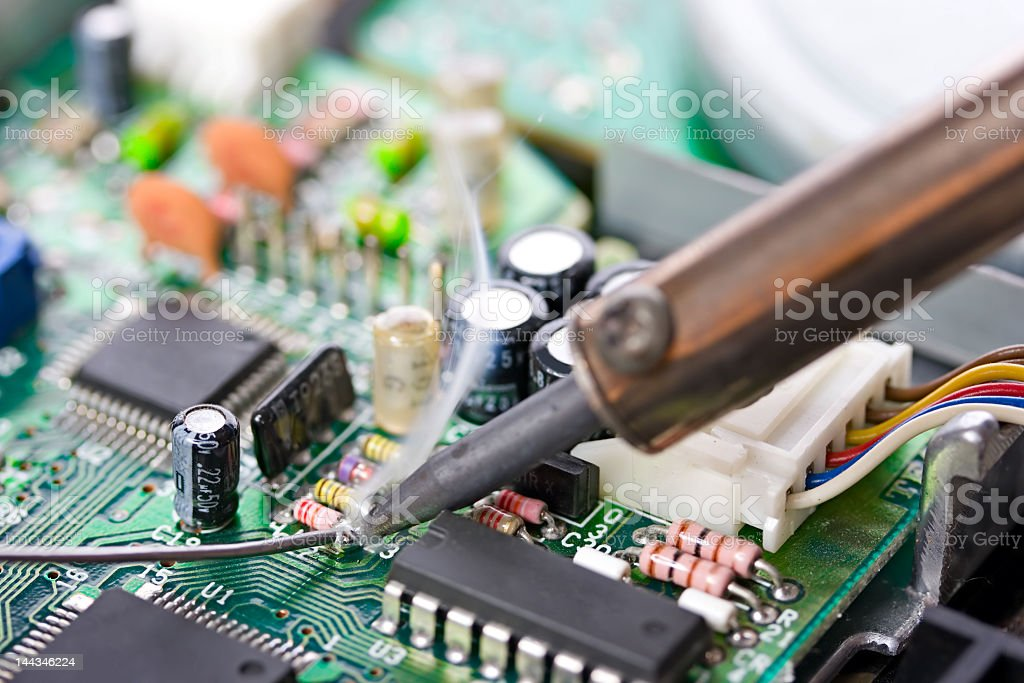 Soldering a circuit board stock photo