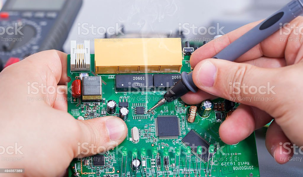 Soldering a circuit board royalty-free stock photo