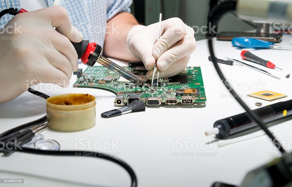 Soldering a computer board stock photo