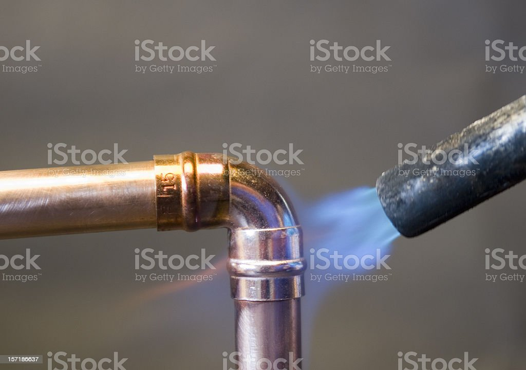 Soldering a copper pipe stock photo