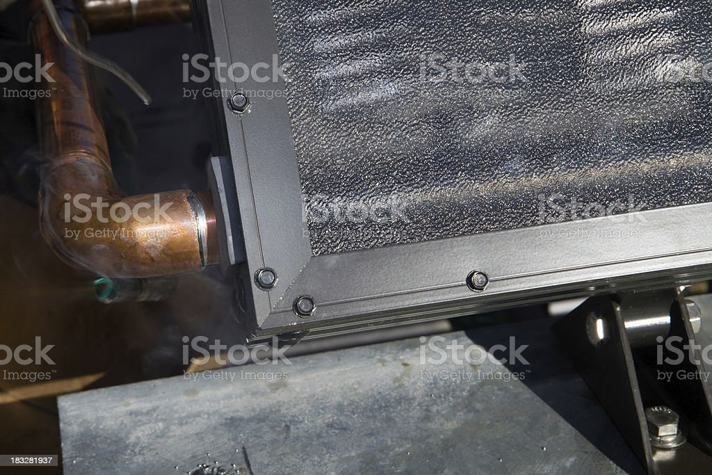 Soldering a New Solar Water Heating Panel Pipe royalty-free stock photo