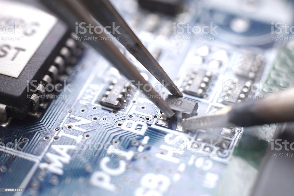 Soldering and assembly of SMD transistor stock photo