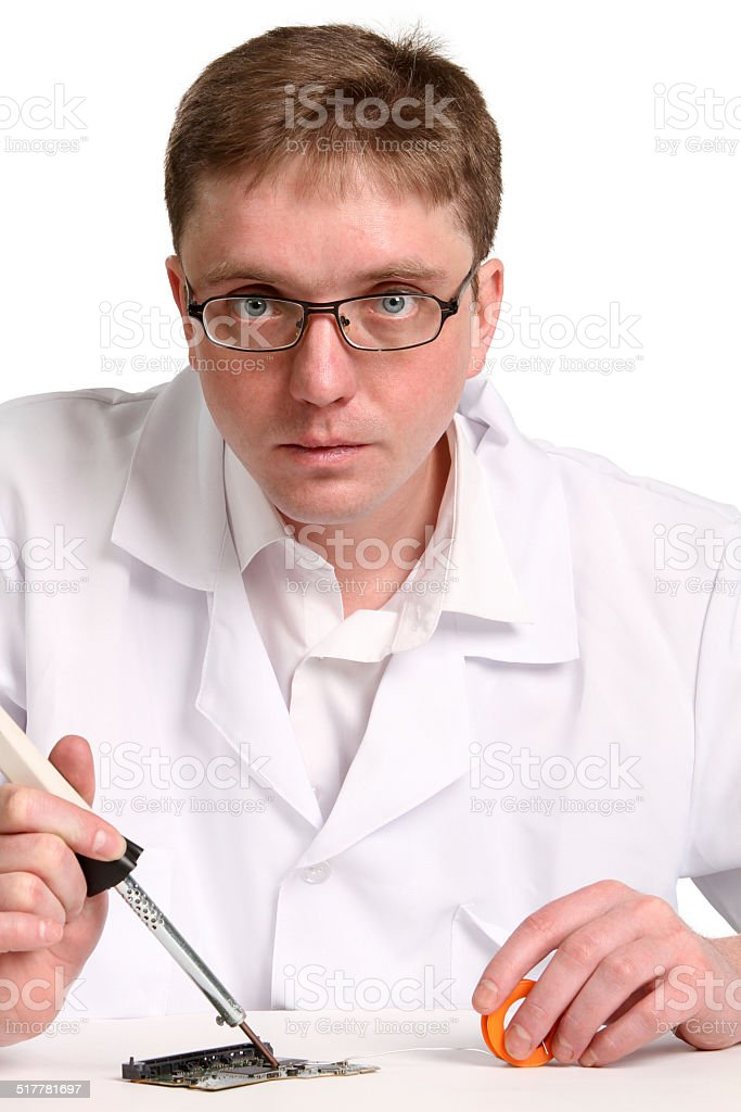 soldering iron in his hand stock photo