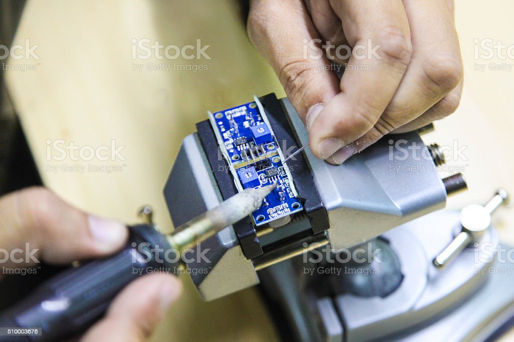 Soldering microchip stock photo