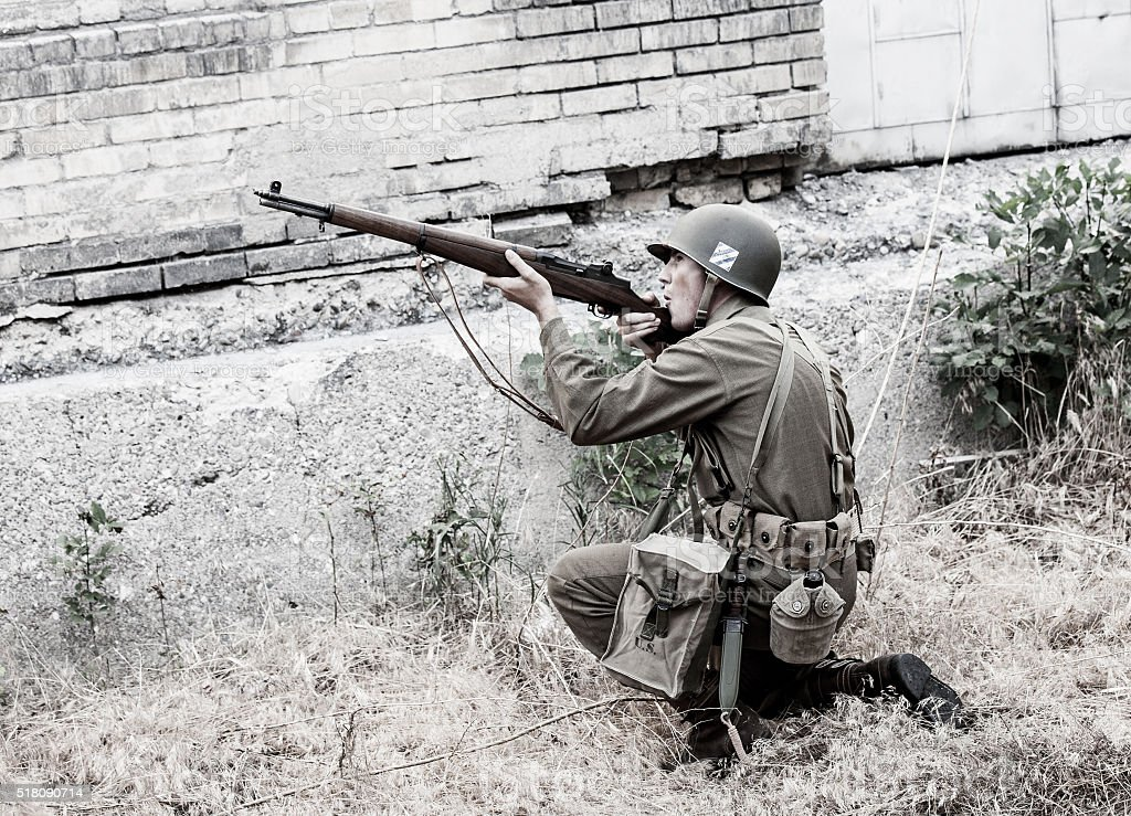 Soldier Aiming a Rifle WWII stock photo