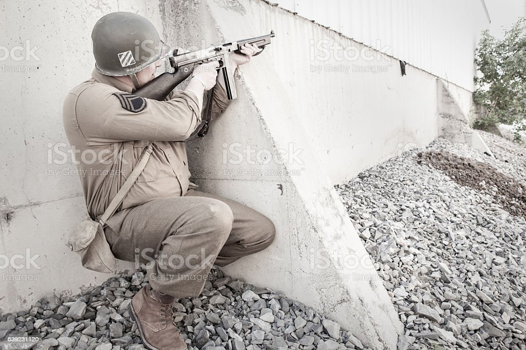 Soldier Aiming a Sub Machine Gun WWII stock photo