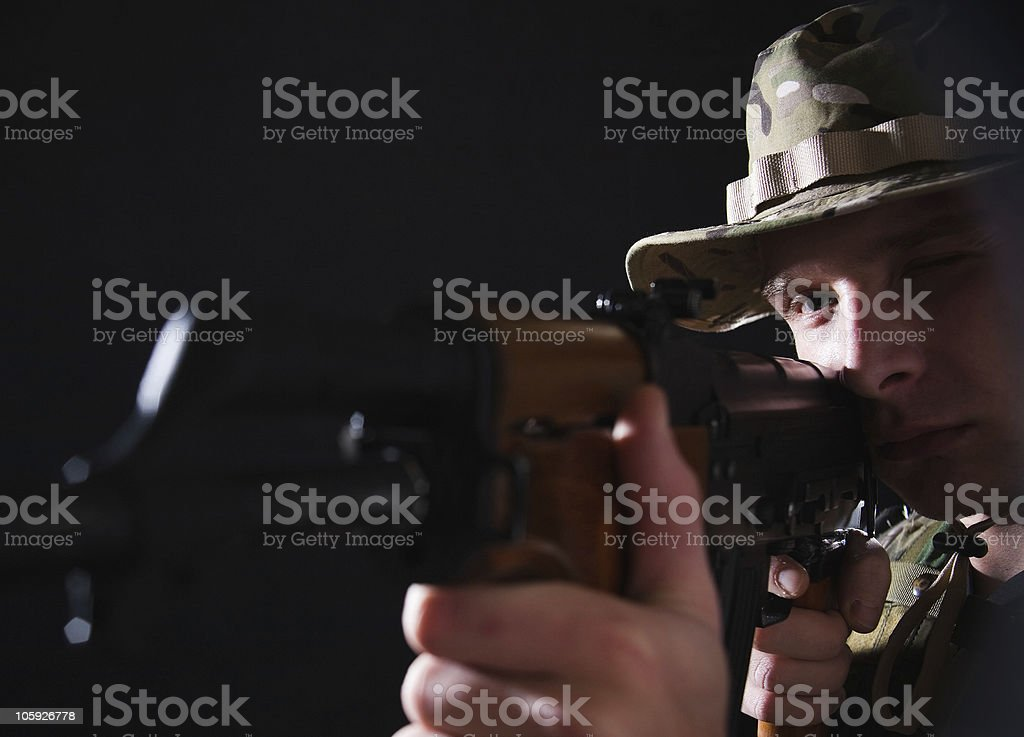 Soldier aiming Kalashnikov royalty-free stock photo