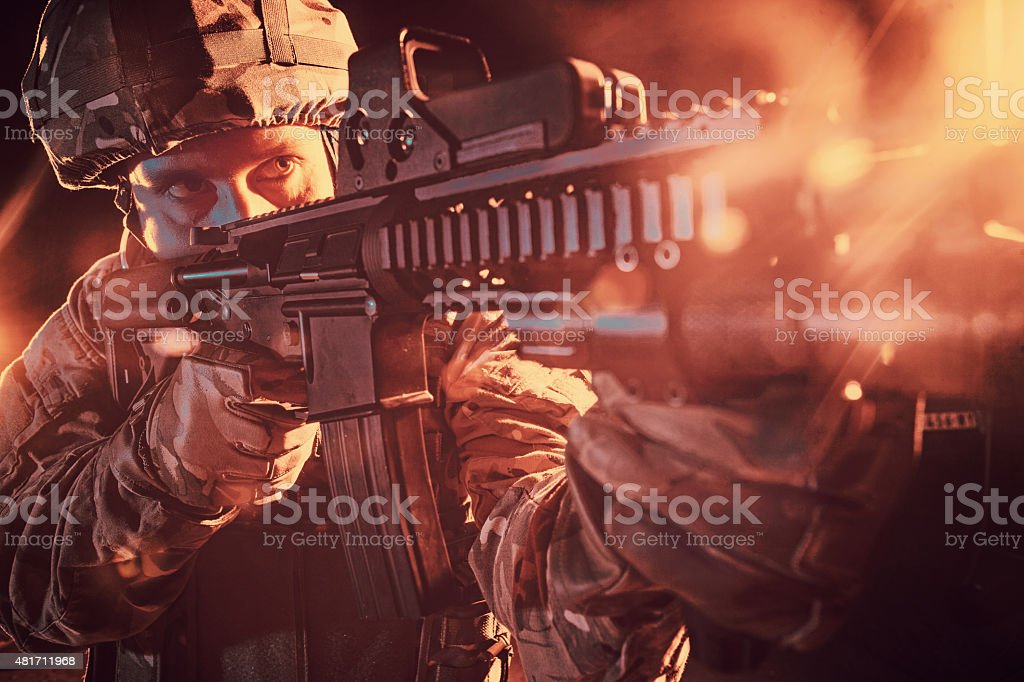 soldier aiming stock photo